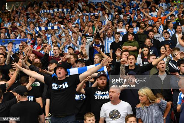 Huddersfield Town supporters sing and cheer prior to the English Premier League football match between Huddersfield Town and Newcastle United at the...