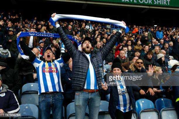 Huddersfield Town supporters singing during the Sky Bet Championship match between Huddersfield Town and Leeds United at John Smith's Stadium on...