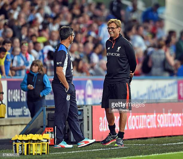 Huddersfield Town v Liverpool Jurgen klopp Manager of Liverpool in action with David Wagner Manager of Hudersfield Town during the PreSeason Friendly...