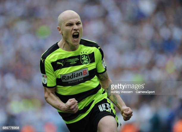 Huddersfield Town's Aaron Mooy celebrates his successful penalty during the shoot out in the EFL Sky Bet Championship PlayOff Final victory over...