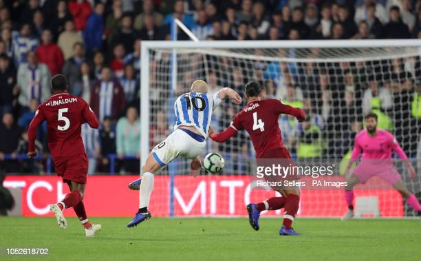 Huddersfield Town's Aaron Mooy has a shot on goal during the Premier League match at the John Smith's Stadium Huddersfield