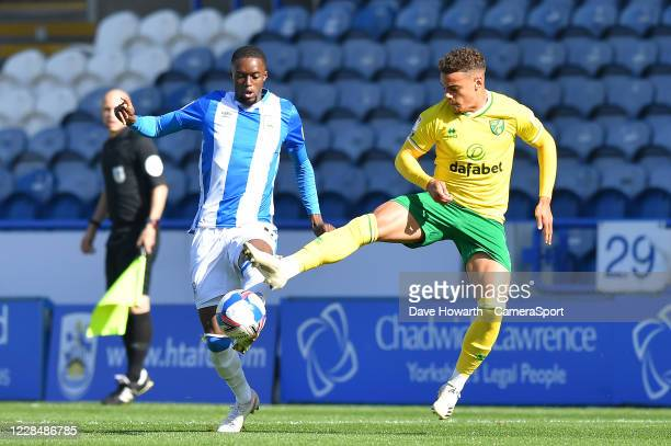 Huddersfield Town's Adama Diakhaby battles with Norwich City's Oliver Skipp during the Sky Bet Championship match between Huddersfield Town and...