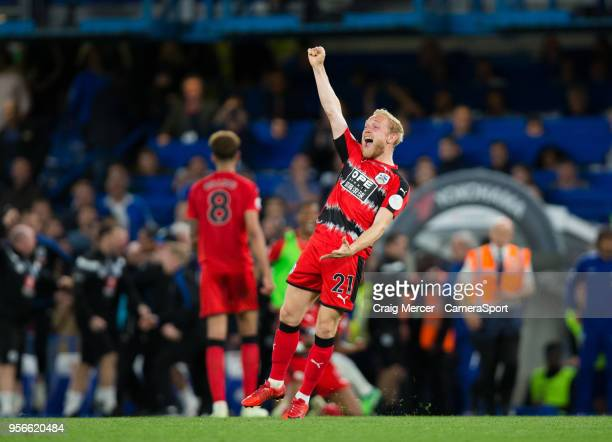 Huddersfield Town's Alex Pritchard celebrates at the final whistle during the Premier League match between Chelsea and Huddersfield Town at Stamford...