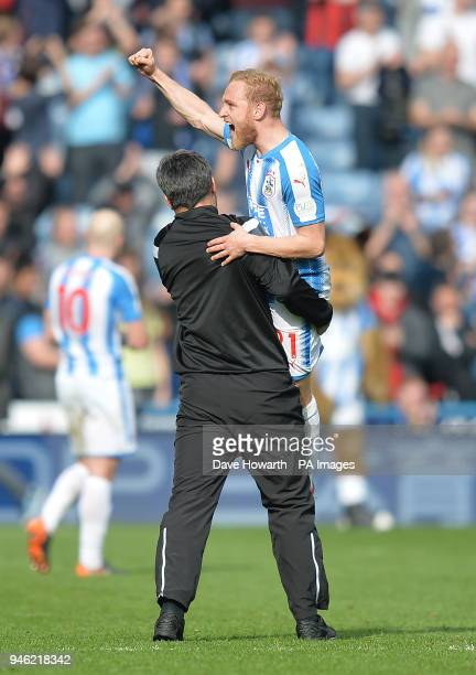 Huddersfield Town's Alex Pritchard celebrates the victory with manager David Wagner after the Premier League match at the John Smith's Stadium...
