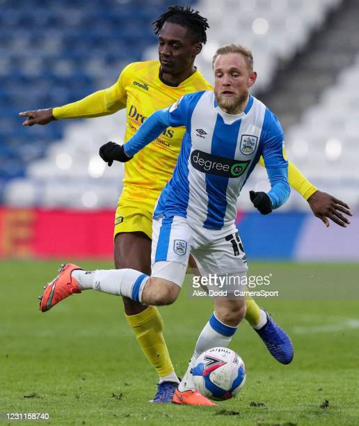 Huddersfield Town's Alex Pritchard is fouled by Wycombe Wanderers' Anthony Stewart during the Sky Bet Championship match between Huddersfield Town...