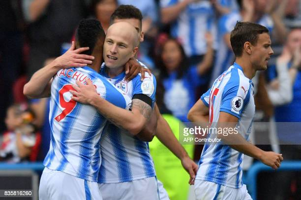 Huddersfield Town's Australian midfielder Aaron Mooy celebrates scoring the team's first goal during the English Premier League football match...