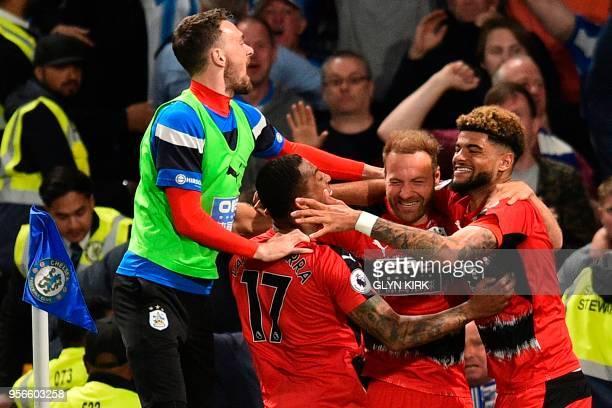 Huddersfield Town's Belgian striker Laurent Depoitre celebrates scoring the opening goal with Huddersfield Town's Danish midfielder Philip Billing...