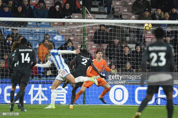 Huddersfield Town's Belgian striker Laurent Depoitre heads the ball to score past Chelsea's Belgian goalkeeper Thibaut Courtois during the English...
