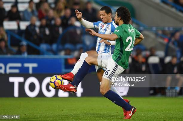 Huddersfield Town's Belgian striker Laurent Depoitre vies with West Bromwich Albion's Egyptian defender Ahmed Hegazy during the English Premier...