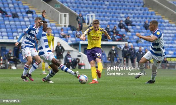 Huddersfield Town's Carel Eiting under pressure from Reading's Alfa Semedo Esteves and Andy Rinomhota as he takes a shot at goal during the Sky Bet...