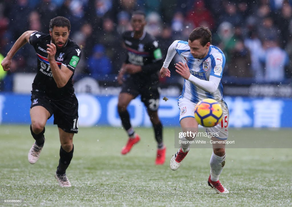 Huddersfield Town's Chris Lowe and Crystal Palace's Andros Townsend during the Premier League match between Huddersfield Town and Crystal Palace at John Smith's Stadium on March 17, 2018 in Huddersfield, England.