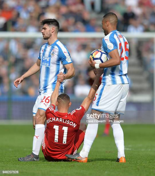 Huddersfield Town's Christopher Schindler and Mathias Zanka Jorgensen help Watford's Richarlison to his feet during the Premier League match at the...