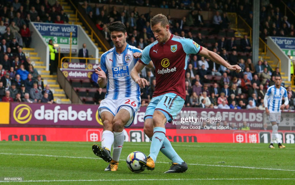 Huddersfield Town's Christopher Schindler blocks the shot from Burnley's Chris Wood during the Premier League match between Burnley and Huddersfield Town at Turf Moor on September 23, 2017 in Burnley, England.