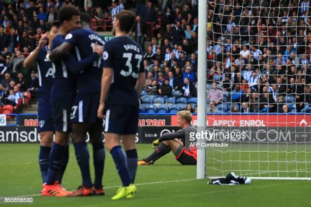 Huddersfield Town's Danish goalkeeper Jonas Lossi reacts as Tottenham Hotspur's French midfielder Moussa Sissoko celebrates scoring the team's fourth...