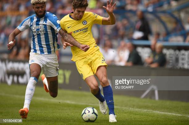 Huddersfield Town's Danish midfielder Philip Billing vies with Chelsea's Spanish defender Marcos Alonso during the English Premier League football...