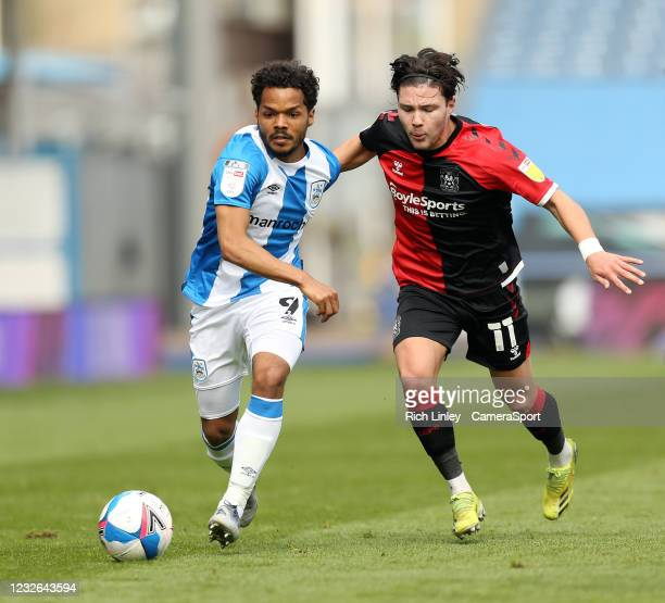 Huddersfield Town's Duane Holmes under pressure from Coventry City's Callum O'Hare during the Sky Bet Championship match between Huddersfield Town...