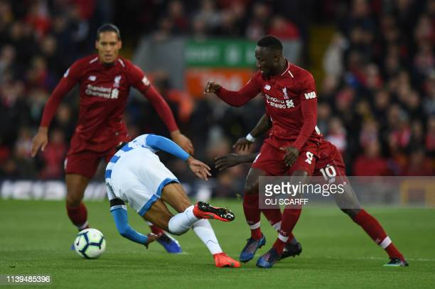 Huddersfield Town's Dutch midfielder Juninho Bacuna is tackled by Liverpool's Guinean midfielder Naby Keita during the English Premier League...