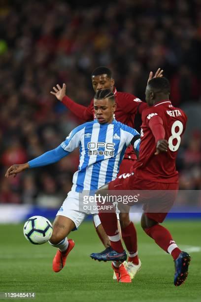 Huddersfield Town's Dutch midfielder Juninho Bacuna vies with Liverpool's Guinean midfielder Naby Keita during the English Premier League football...