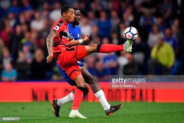 Huddersfield Town's Dutch midfielder Rajiv van La Parra plays the ball under pressure from Chelsea's German defender Antonio Rudiger during the...