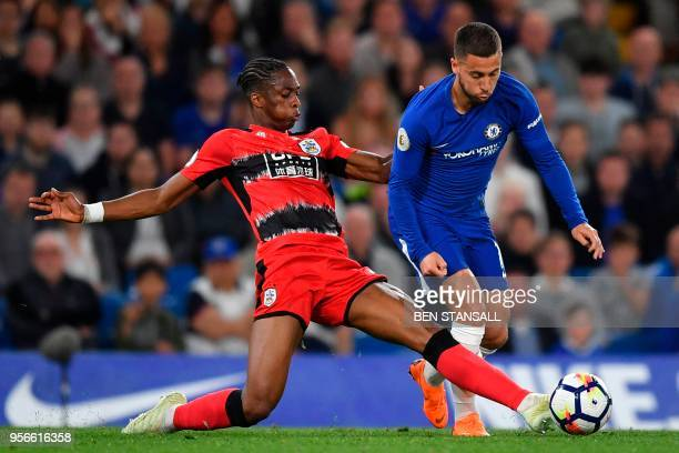 Huddersfield Town's Dutch midfielder Rajiv van La Parra stretches to attempt a tackle on Chelsea's Belgian midfielder Eden Hazard during the English...