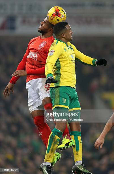 Huddersfield Town's Elias Kachunga and Norwich City's Martin Olsson battle for the ball during the Sky Bet Championship match at Carrow Road Norwich