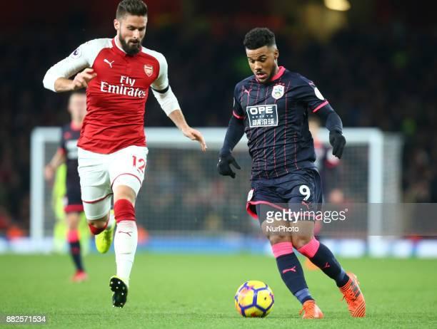 Huddersfield Town's Elias Kachunga beats Arsenal's Olivier Giroud during Premier League match between Arsenal and Huddersfield Town at Emirates...