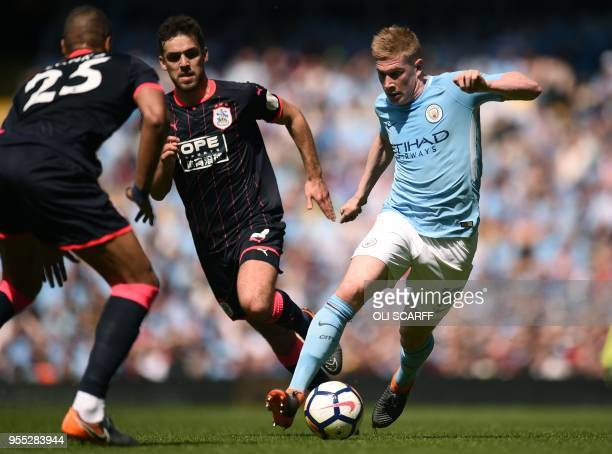 Huddersfield Town's English defender Tommy Smith vies with Manchester City's Belgian midfielder Kevin De Bruyne during the English Premier League...