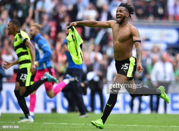 Huddersfield Town's English midfielder Kasey Palmer celebrates after Huddersfield Town's German defender Christopher Schindler scores the final...