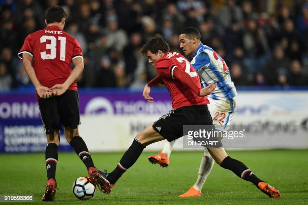 Huddersfield Town's English midfielder Tom Ince has an unsuccessful shot as Manchester United's Serbian midfielder Nemanja Matic and Manchester...