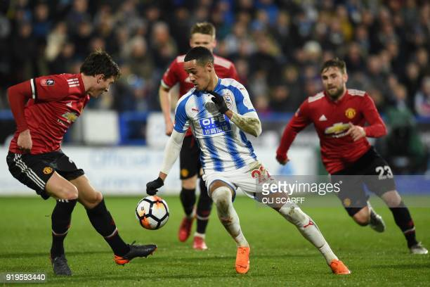 Huddersfield Town's English midfielder Tom Ince vies with Manchester United's Swedish defender Victor Lindelof during the English FA Cup fifth round...