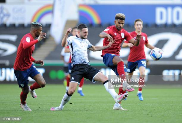 Huddersfield Town's Fraizer Campbell and Swansea City's Matt Grimes clash during the Sky Bet Championship match between Swansea City and Huddersfield...