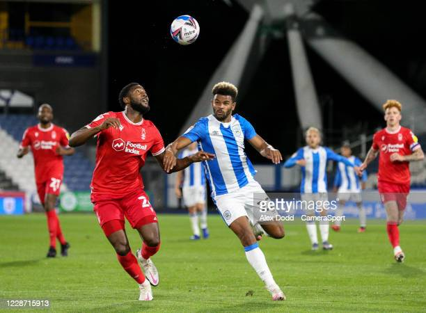 Huddersfield Town's Fraizer Campbell vies for possession with Nottingham Forest's Tyler Blackett during the Sky Bet Championship match between...