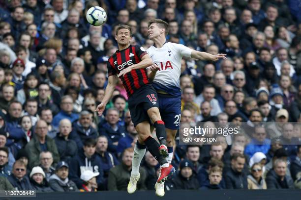 Huddersfield Town's German defender Chris Lowe vies with Tottenham Hotspur's Argentinian defender Juan Foyth during the English Premier League...