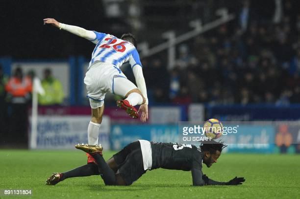 Huddersfield Town's German defender Christopher Schindler tackles Chelsea's Belgian striker Michy Batshuayi during the English Premier League...
