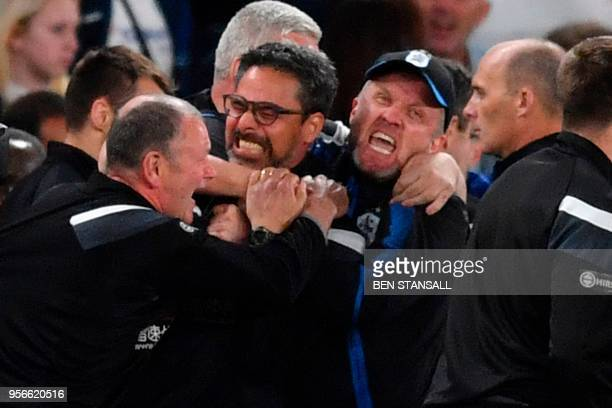 Huddersfield Town's German head coach David Wagner and his assistant head coach Christoph Buhler celebrate at the final whistle during the English...