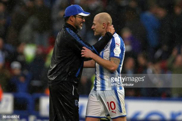 Huddersfield Town's German head coach David Wagner celebrates with Huddersfield Town's Australian midfielder Aaron Mooy on the pitch after the...