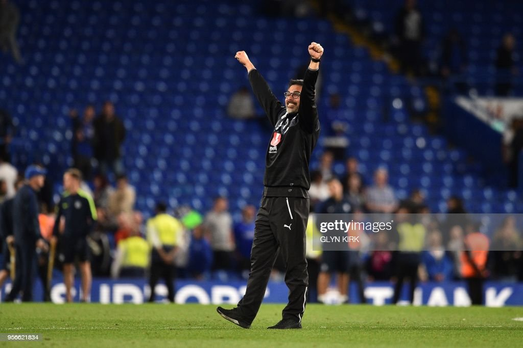 Huddersfield Town's German head coach David Wagner gestures to the fans as he celebrates after the final whistle during the English Premier League football match between Chelsea and Huddersfield Town at Stamford Bridge in London on May 9, 2018. - Huddersfield secured their Premier League survival with a 1-1 draw at Stamford Bridge on Wednesday. (Photo by Glyn KIRK / AFP) / RESTRICTED TO EDITORIAL USE. No use with unauthorized audio, video, data, fixture lists, club/league logos or 'live' services. Online in-match use limited to 75 images, no video emulation. No use in betting, games or single club/league/player publications. /