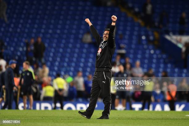 Huddersfield Town's German head coach David Wagner gestures to the fans as he celebrates after the final whistle during the English Premier League...
