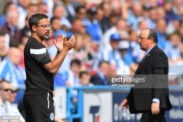 Huddersfield Town's German head coach David Wagner looks on as Newcastle United's Spanish manager Rafael Benitez walks during the English Premier...