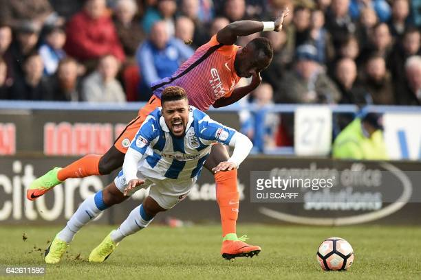 Huddersfield Town's German striker Elias Kachunga is fouled by Manchester City's French defender Bacary Sagna during the English FA Cup fifth round...