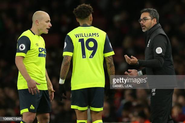 Huddersfield Town's GermanUS head coach David Wagner chats with Huddersfield Town's Germanborn US midfielder Danny Williams and Huddersfield Town's...