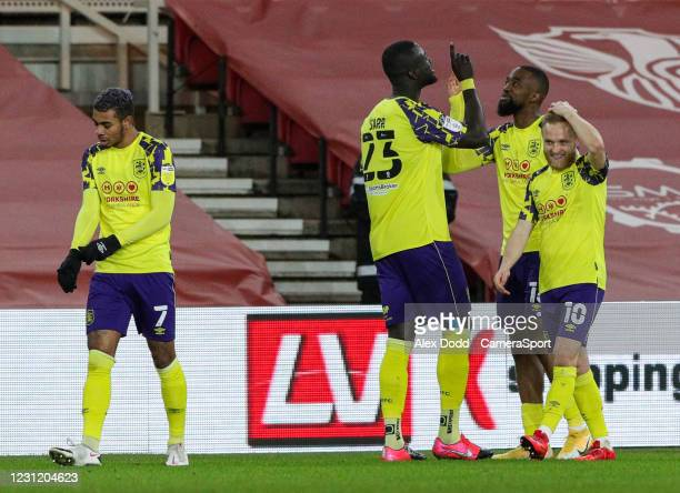 Huddersfield Town's Isaac Mbenza celebrates scoring the opening goal with Mouhamadou-Naby Sarr and Alex Pritchard during the Sky Bet Championship...