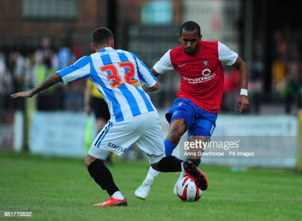Huddersfield Town's Jack Hunt and York City's Ashley Chambers in action during a pre season friendly match at Bootham Crescent York