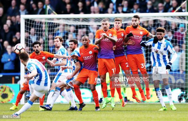 Huddersfield Town's Jack Payne has a free kick attempt on goal