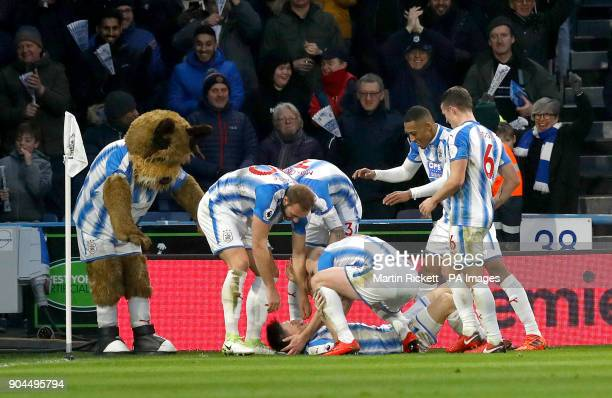 Huddersfield Town's Joe Lolley celebrates scoring his side's first goal of the game during the Premier League match at the John Smith's Stadium...