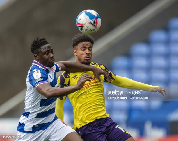 Huddersfield Town's Josh Koroma battles with Reading's Andy Yiadom during the Sky Bet Championship match between Reading and Huddersfield Town at...