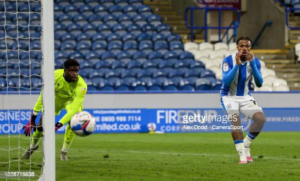 Huddersfield Town's Josh Koroma sees his shot saved by Nottingham Forest's Brice Samba late in the game during the Sky Bet Championship match between...