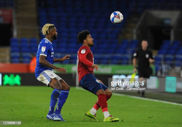 Huddersfield Town's Josh Koroma shields the ball from Cardiff City's Leandro Bacuna during the Sky Bet Championship match between Cardiff City and...