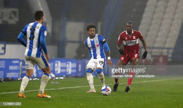 Huddersfield Town's Josh Koroma shields the ball from Middlesbrough's Anfernee Dijksteel during the Sky Bet Championship match between Huddersfield...