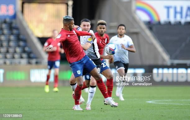 Huddersfield Town's Juninho Bacuna battles with Swansea City's Matt Grimes during the Sky Bet Championship match between Swansea City and...